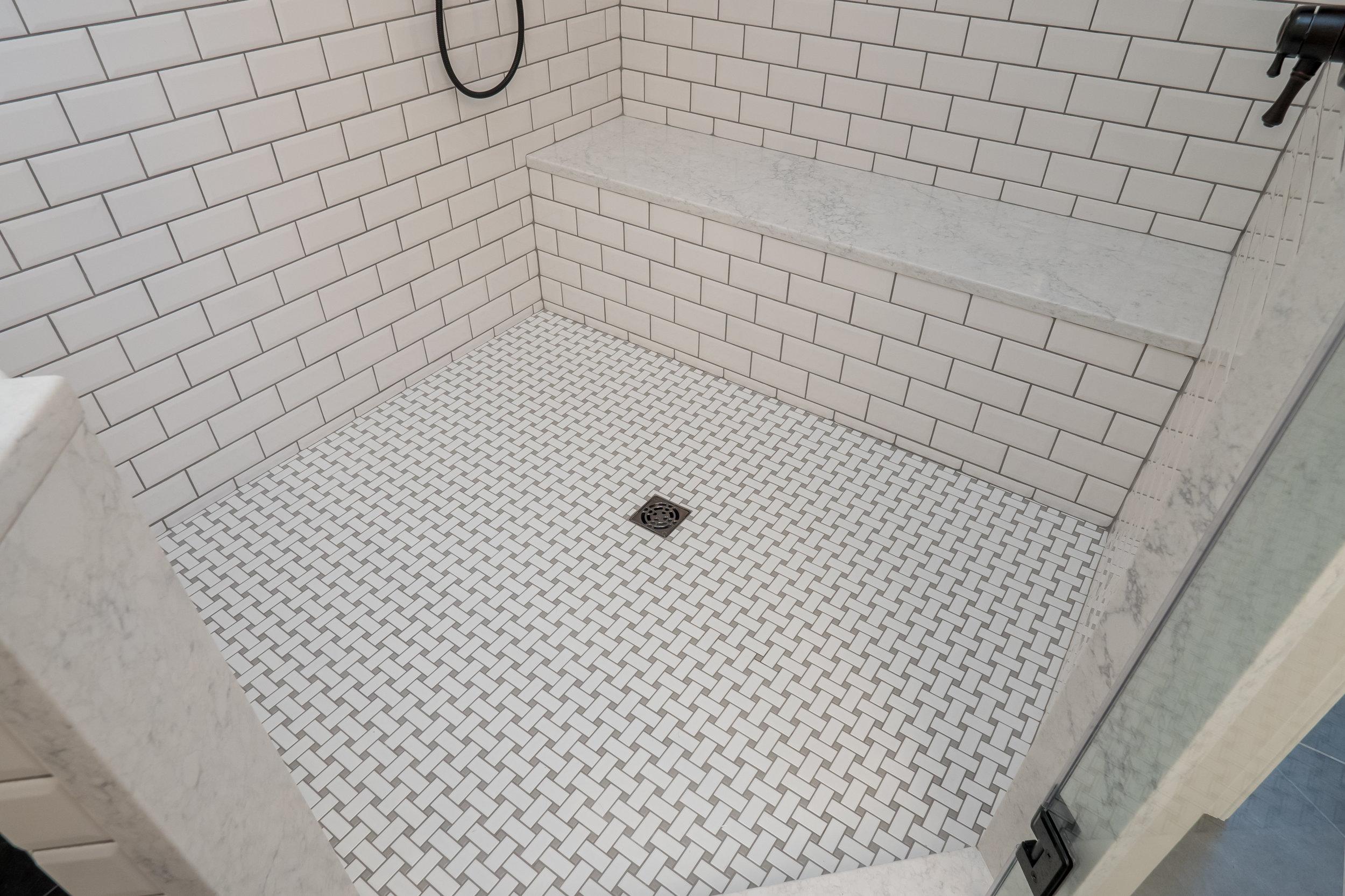 classy bathroom remodel + chesapeake + shower tile+ benson Homes.jpg
