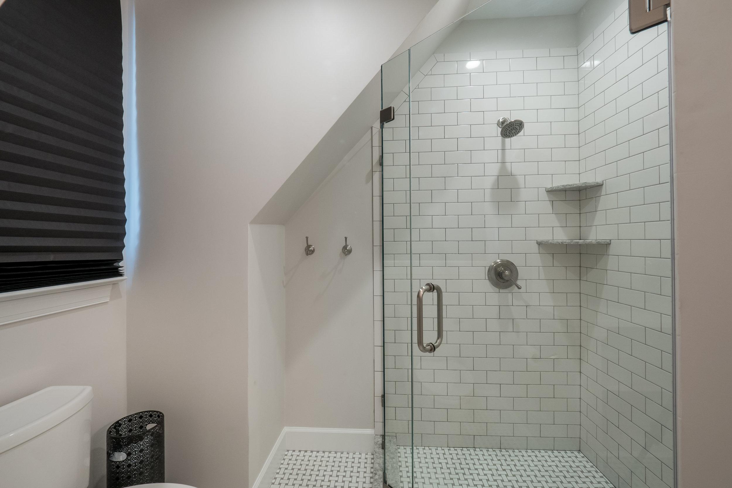 glass shower white tile modern bathroom remodel hampton roads benson homes.jpg