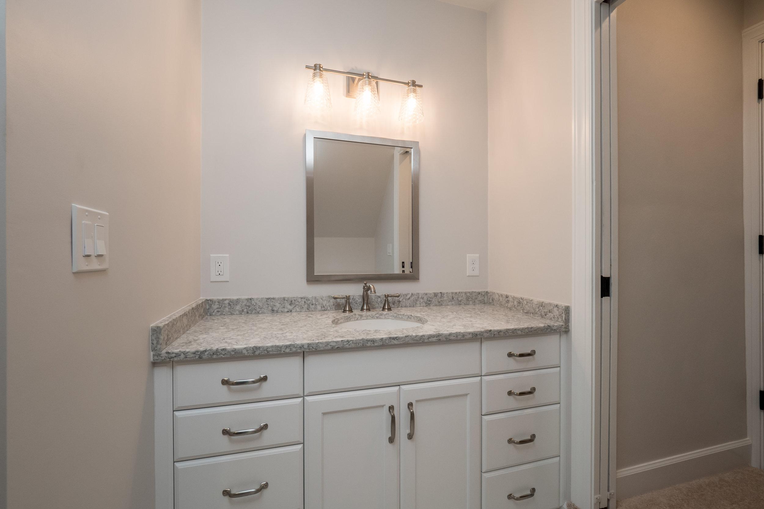 sink and mirror bathroom remodel neutral colors benson homes.jpg