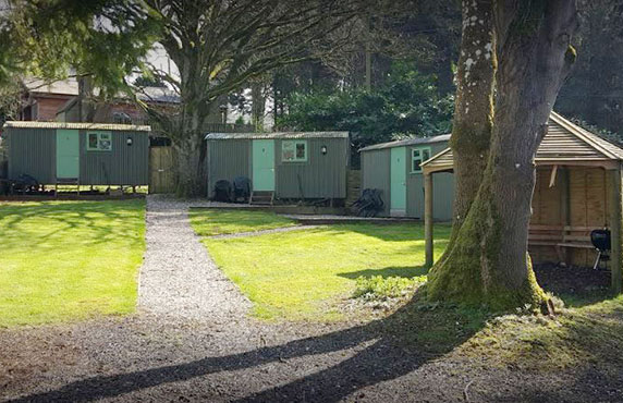 THREE SHEPHERDS HUTS AND A COVERED BBQ AREA