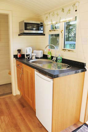 shepherds-hut-glamping-rookery-farm-broadway-kitchen-w.jpg