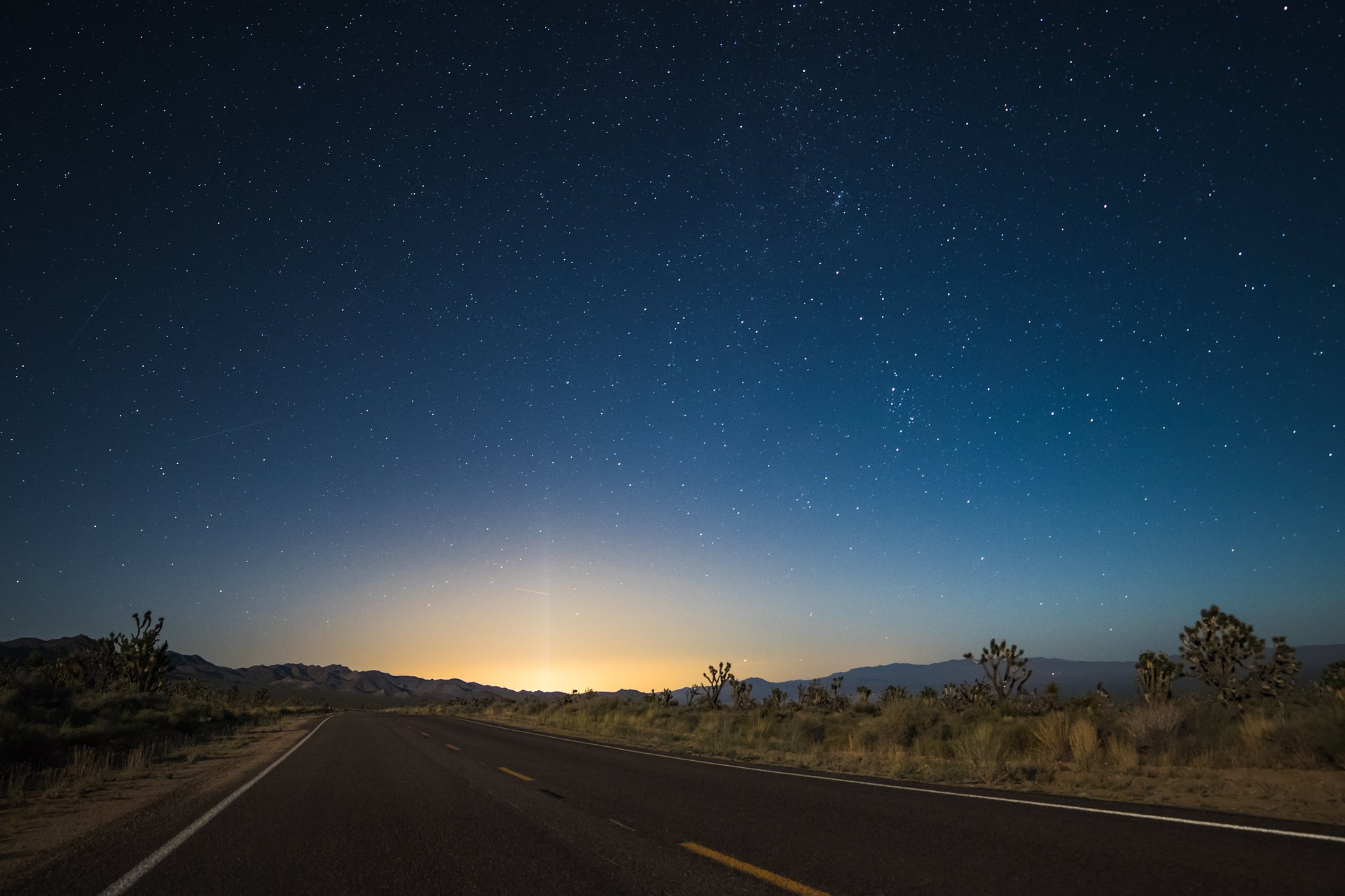Early morning sunrise along desert road.