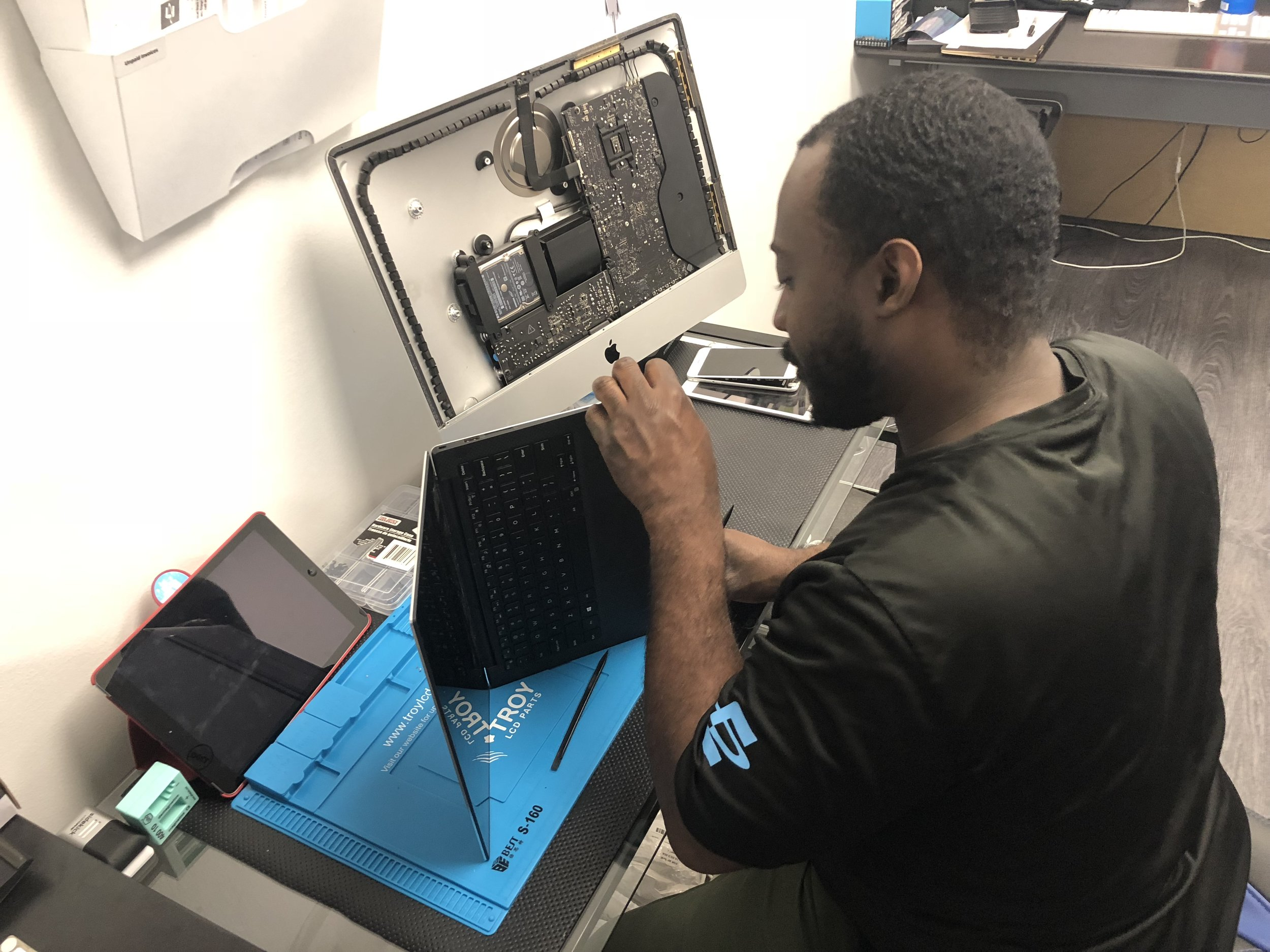 Avery Irby fixing a broken LCD