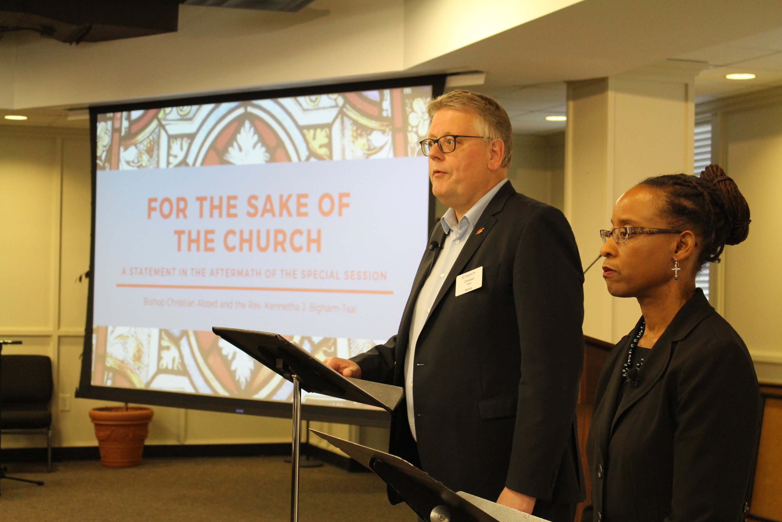 """Bishop Alsted and the Rev. Kennetha J. Bigham-Tsai deliver the """"For the Sake of the Church"""" statement at the Connectional Table meeting in April 2019."""