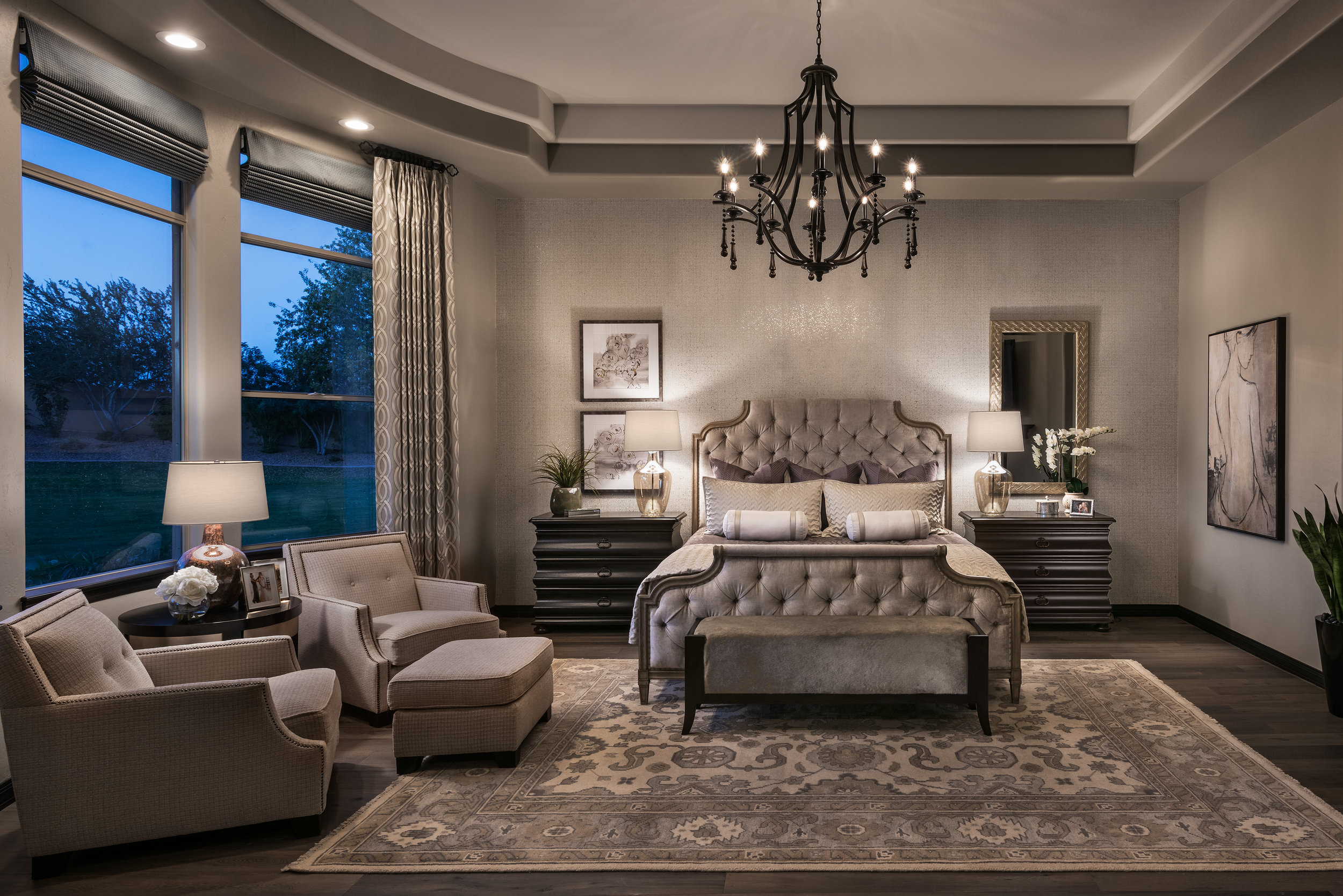 Adding sparkle to this room with embellished wall-covering on the headboard wall along with the new chandelier this master bedroom comes to life.