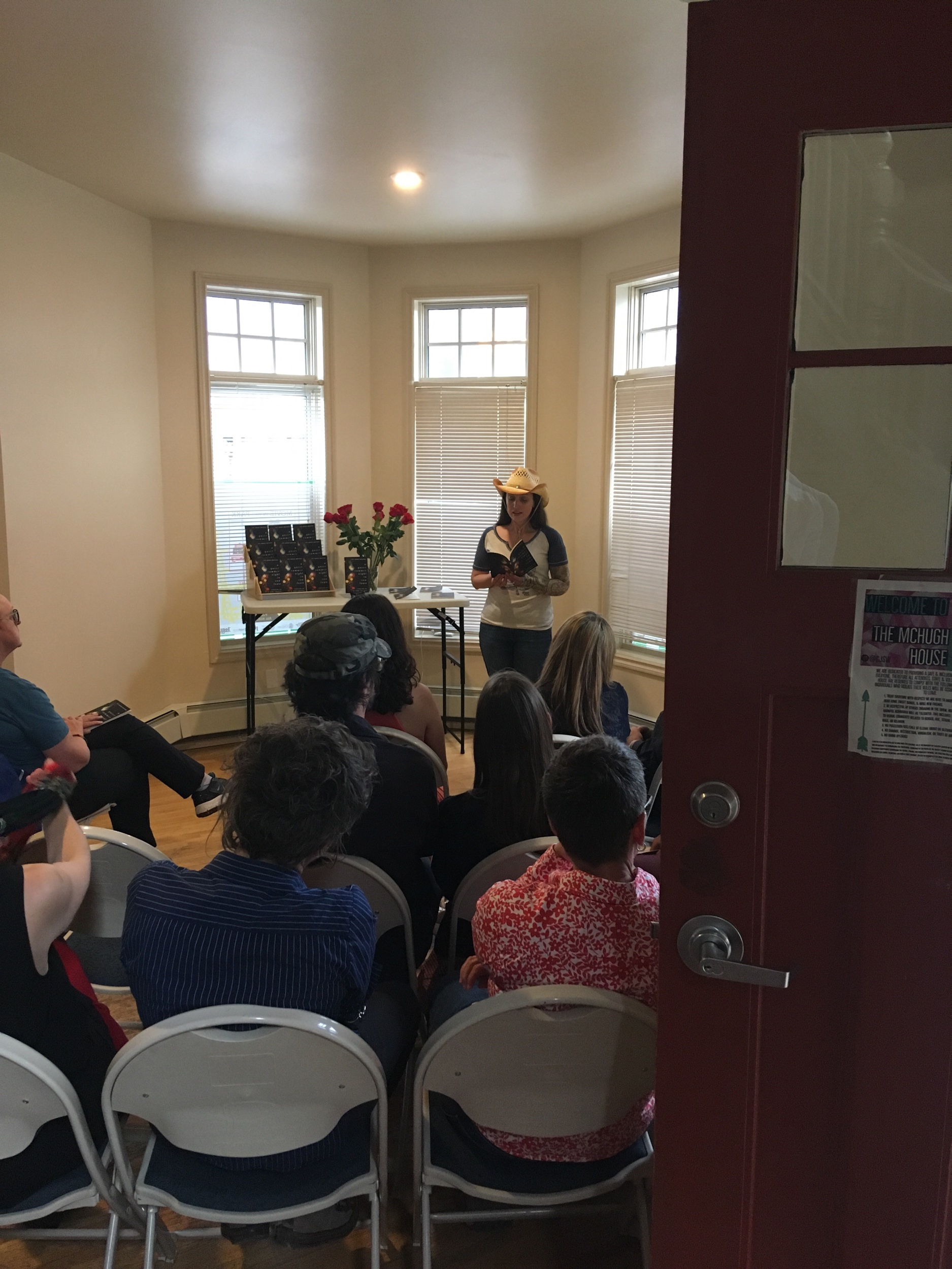 "Me reading an excerpt from my short story ""The Steward of the Treaty 7 Sodium Forest"", which is featured in  A Queer Summer Night in Cowtown,  at the book's launch on July 14, 2019 at McHugh House in Calgary. Photo by Brett Bergie."