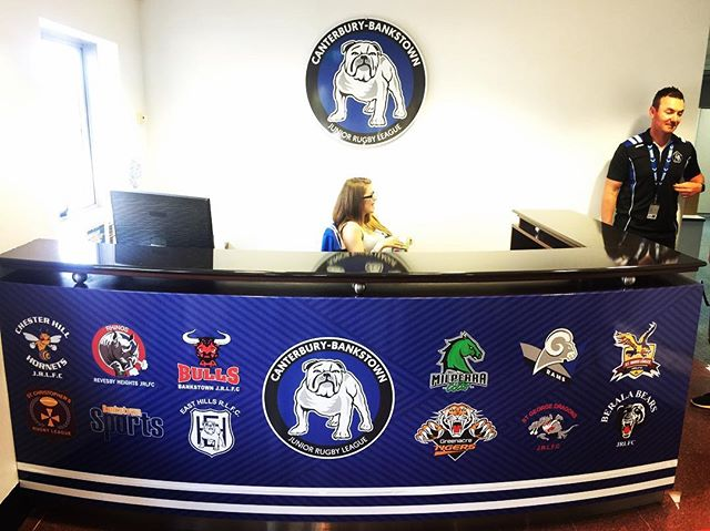 Amazing transformation for the reception desk @nrl_bulldogs For enquiries about how@we@can transform your workplace email design@allstuckup.com.au #allstuckup #canterburybankstownbulldogs #dogsofwar #nrl #footy #stickers