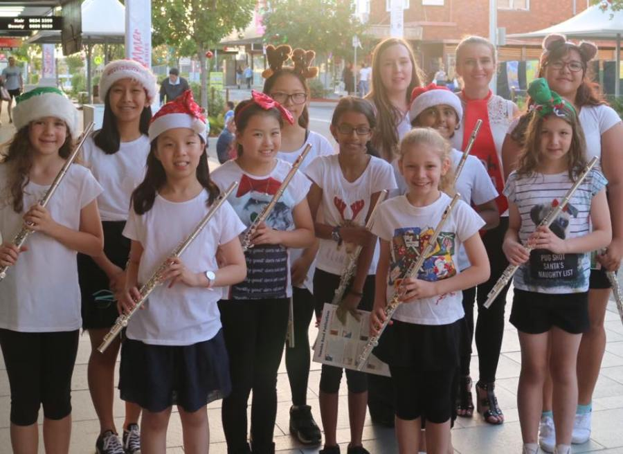 """HSM Flute students after performing at the 2016 """"Castle Hill Sky Show"""" at Castle Towers"""