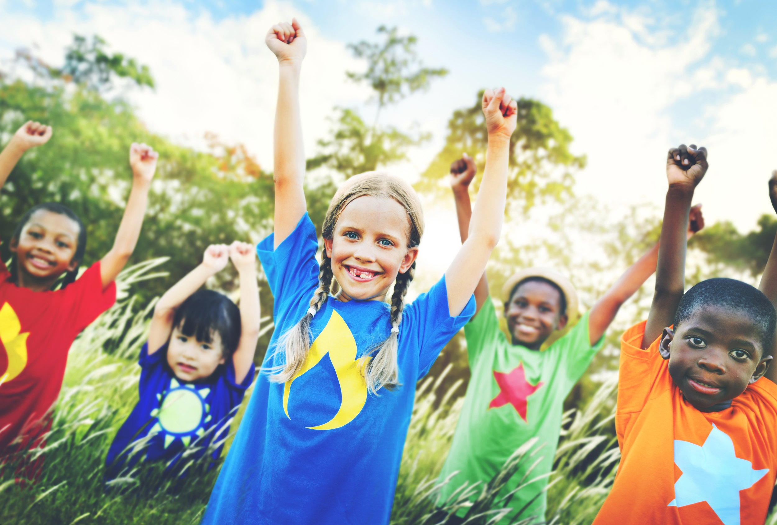 multiethnicity children in coloured Tshirts.jpg