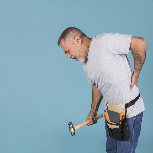 handyman-suffering-from-backpain-holding-hammer-standing-against-blue-background_23-2148032329.jpg