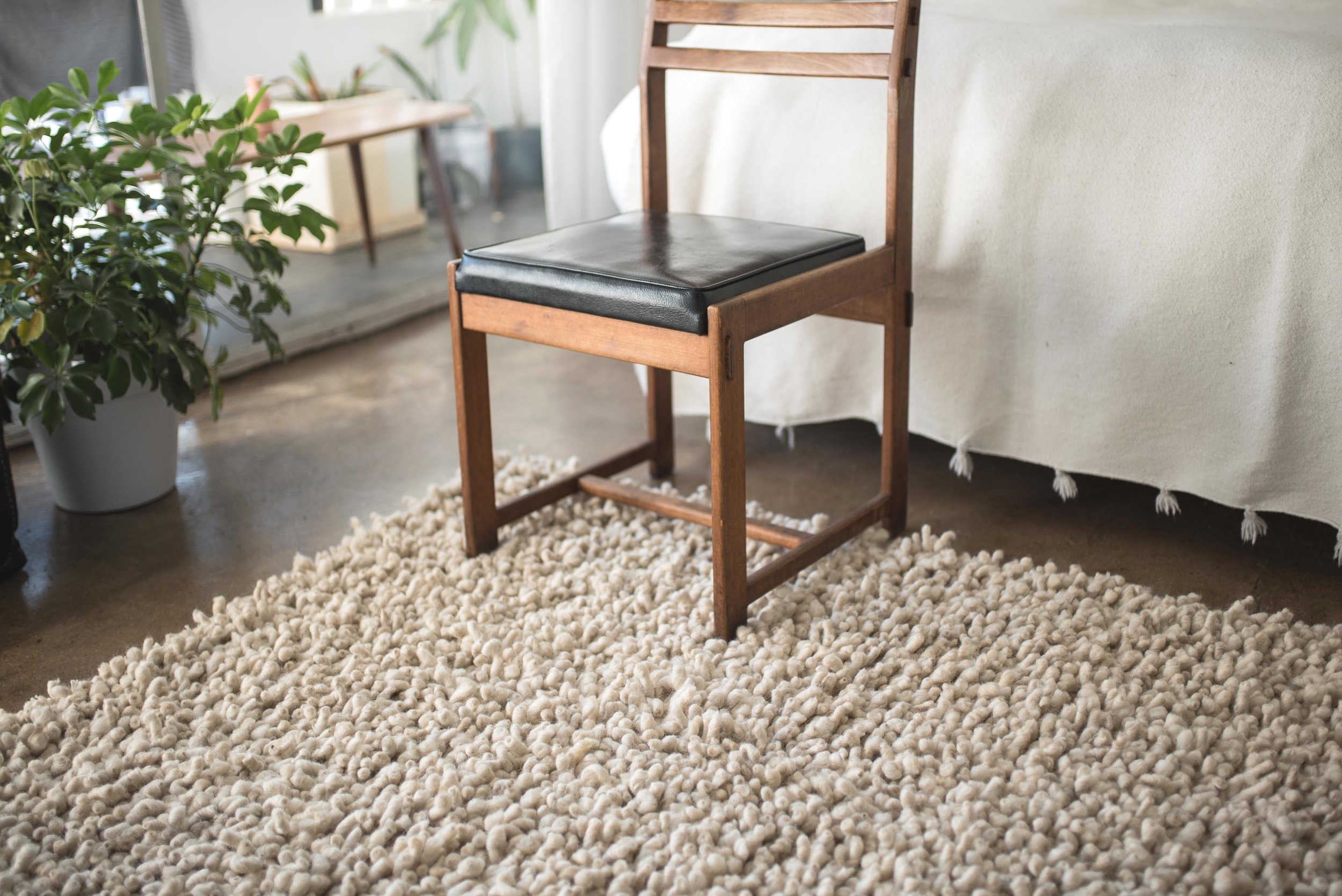 Karakul wool carpet, tufted weave design in natural white