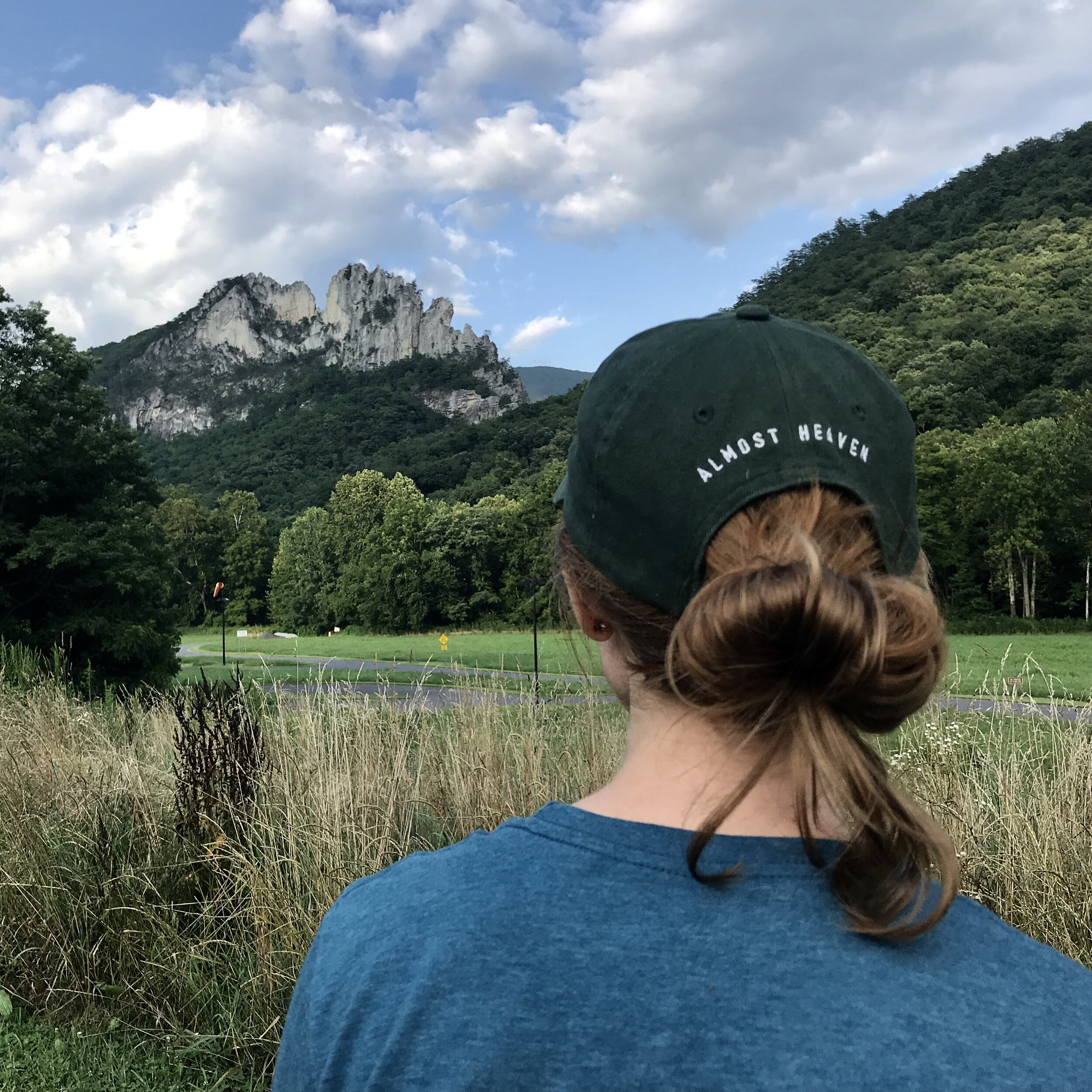 Taking in the grandeur of Seneca Rocks from the parking lot after our hike