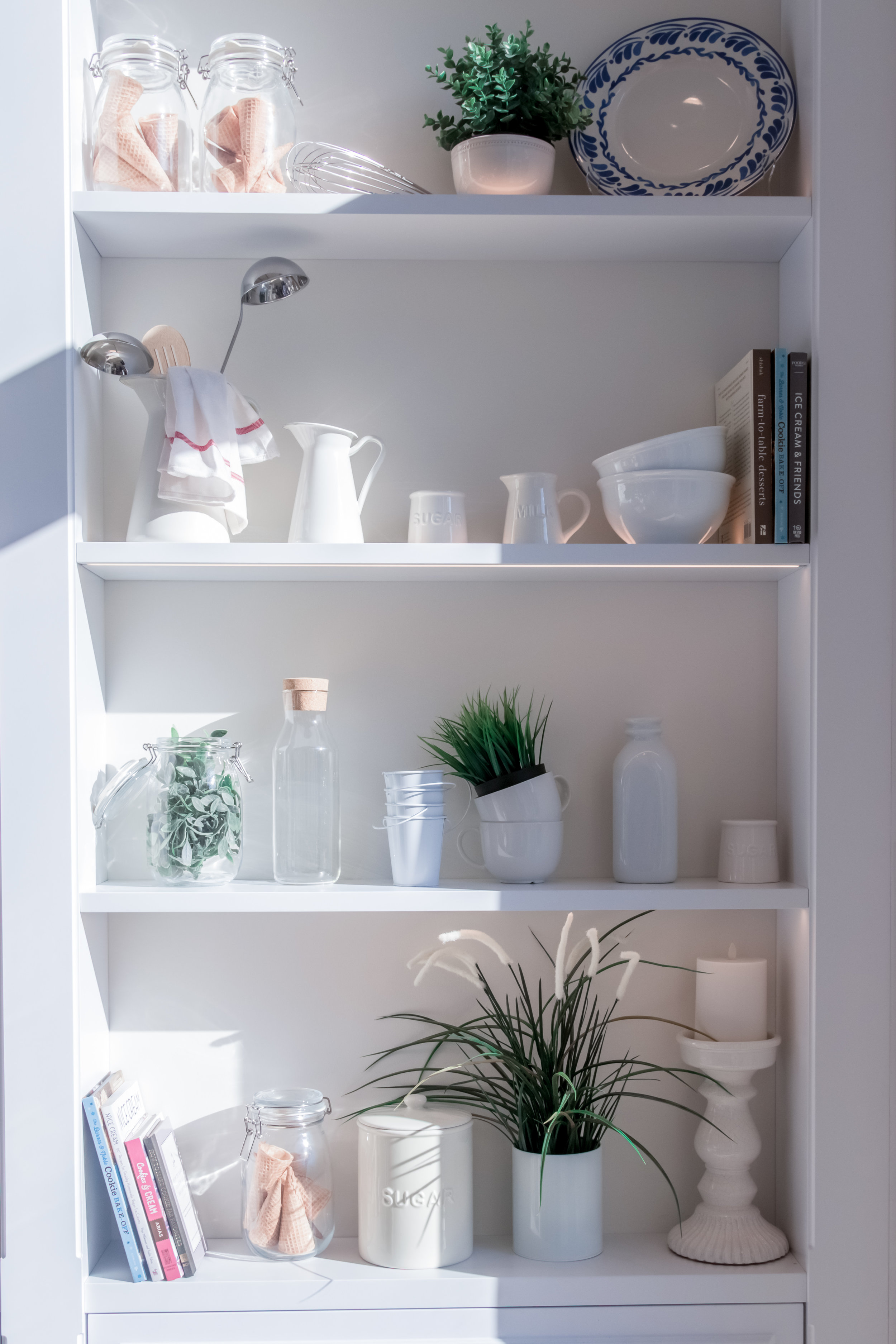 pantry with shelves and jars stacked with food