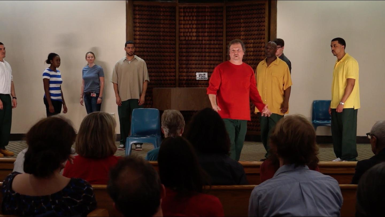 "Nate Performs ""Window Onto Pain"" with the group. Left to right: David Bendezou, Sandra Oyeneyin, Blaize Emily Hall, Leroy Lebron Taylor, Nathan Powell, Michael Rhynes, Nick Fesette, Demetrius Molina."