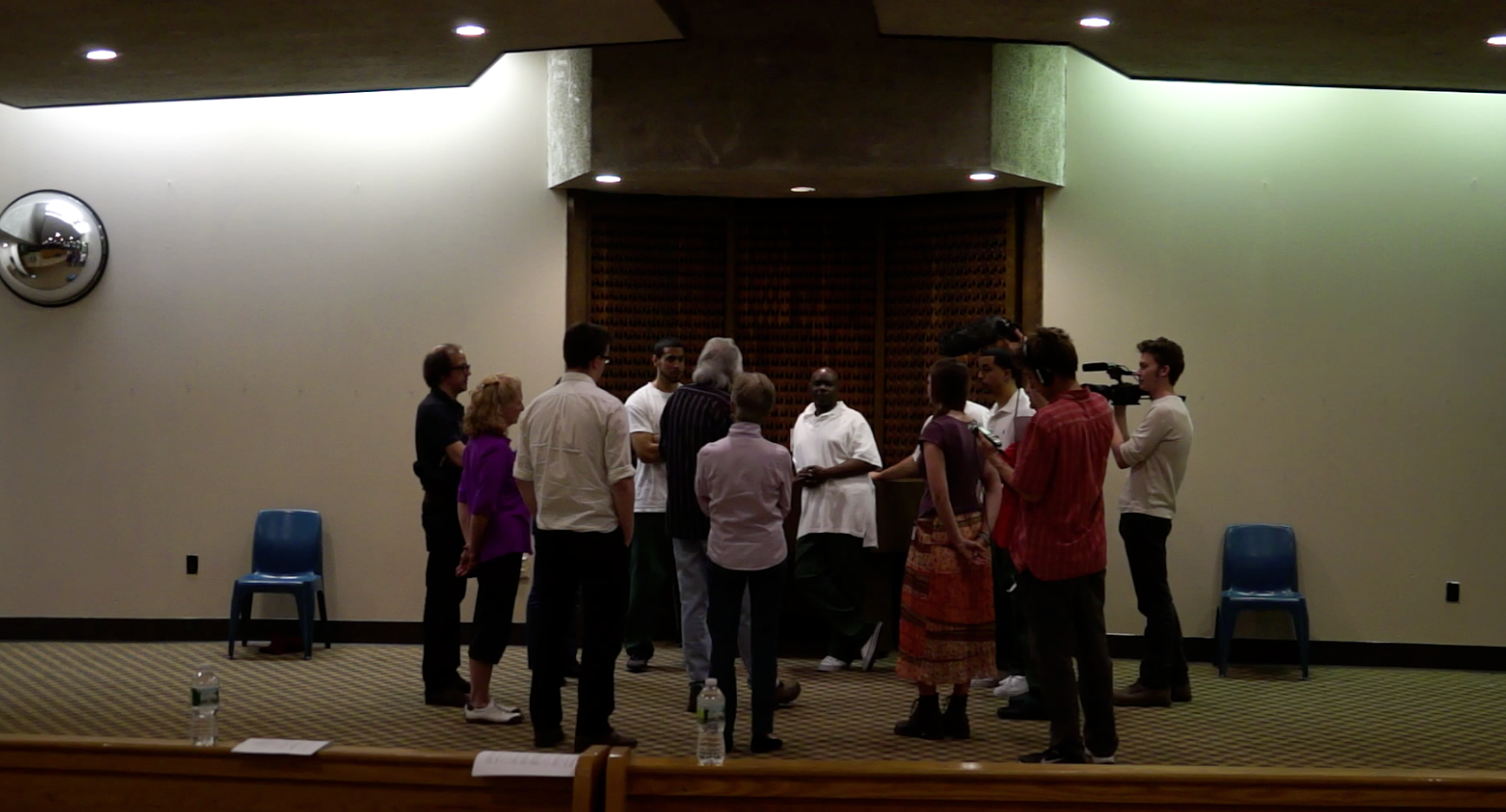 The group meets after the rehearsal in the chapel.