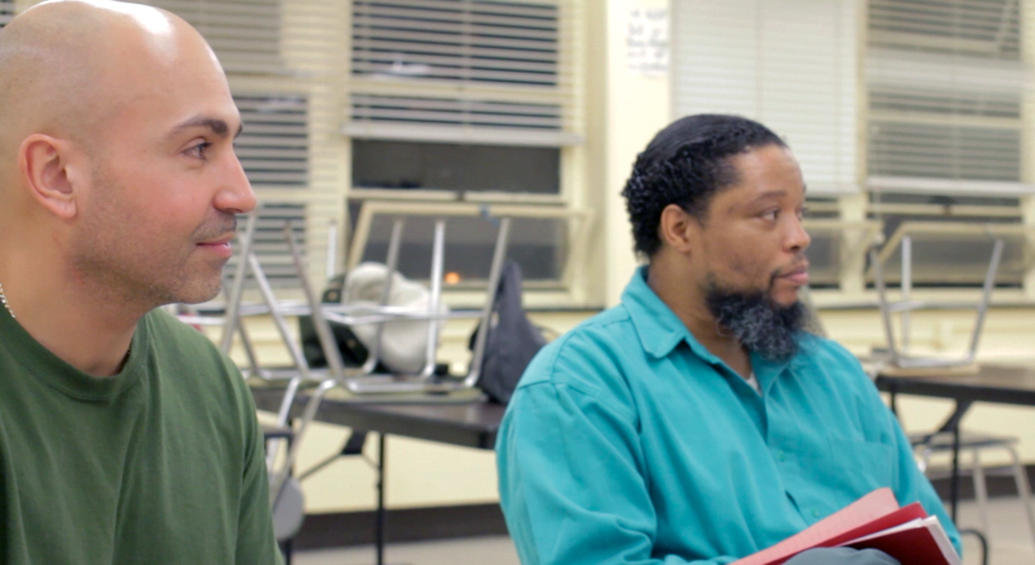 Efraim Diaz and Kenneth Brown listen to a discussion of a piece for performance.