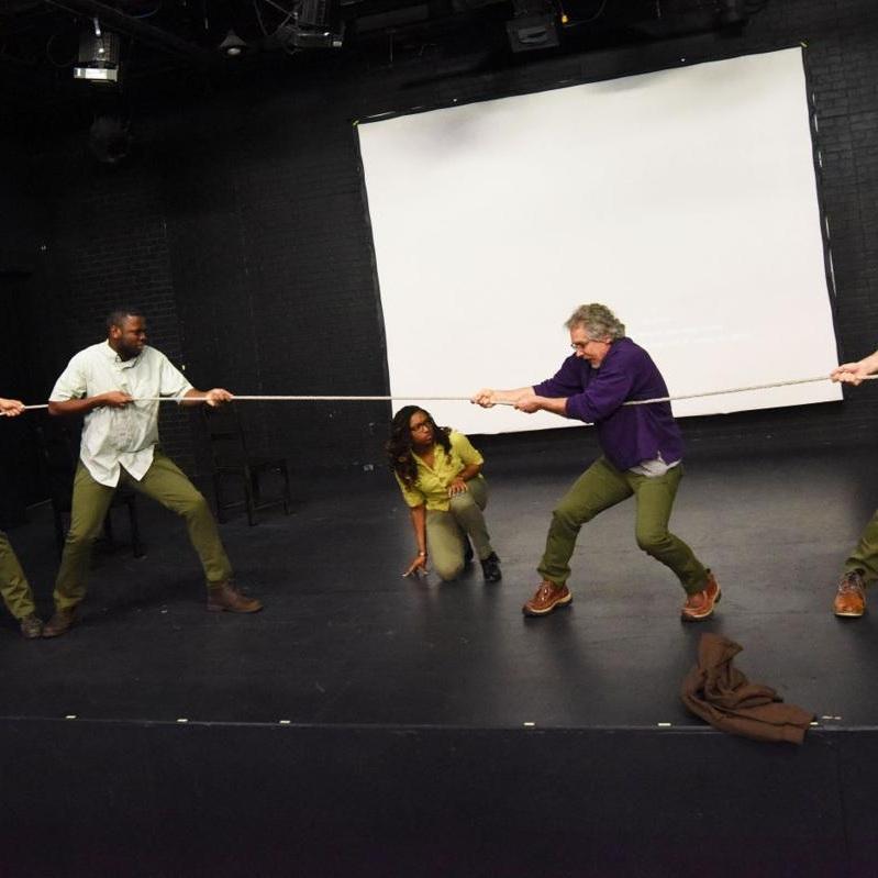 From left: Joshua Mensa, Ezioma Asonye, and Jeff Guyton rehearse a scene from  Human Again  Monday at Auburn Public Theater.  Sarah Jean Condon, The Citizen.