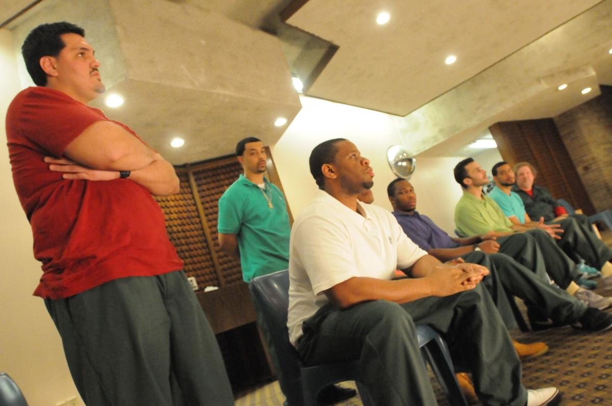 The Phoenix Players Theatre Group takes questions from the audience after its performance of  This Incarcerated Life: The Foundation of a Pipe Dream  Thursday in the Auburn Correctional Facility chapel.