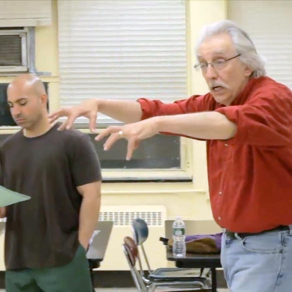 Bruce Levitt (right) leads PPTG rehearsal at Auburn Correctional Facility.