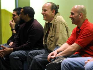 From left, Auburn Correctional Facility inmates David Bendezu, Kenneth Brown, Michael Shane Hale and Efraim Diaz respond to questions after their performance at the prison. The inmates performed personal stories with tones of humor and personal hurting as part of the Phoenix Players Theatre Group.  Katie Roupe / The Citizen
