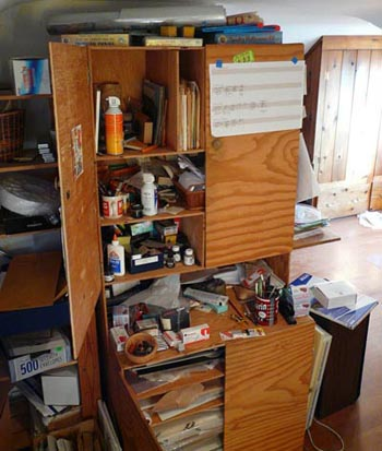 Home-made cupboards work to hold art tools and paper