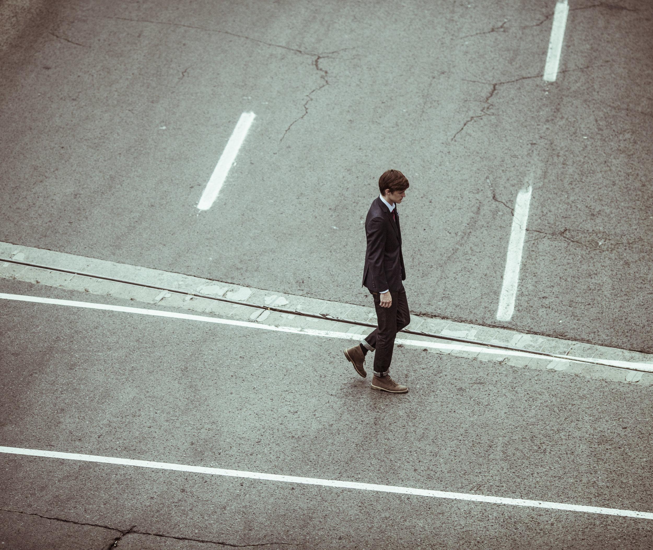 unsplash_lonely_guy_crossing_road.jpg