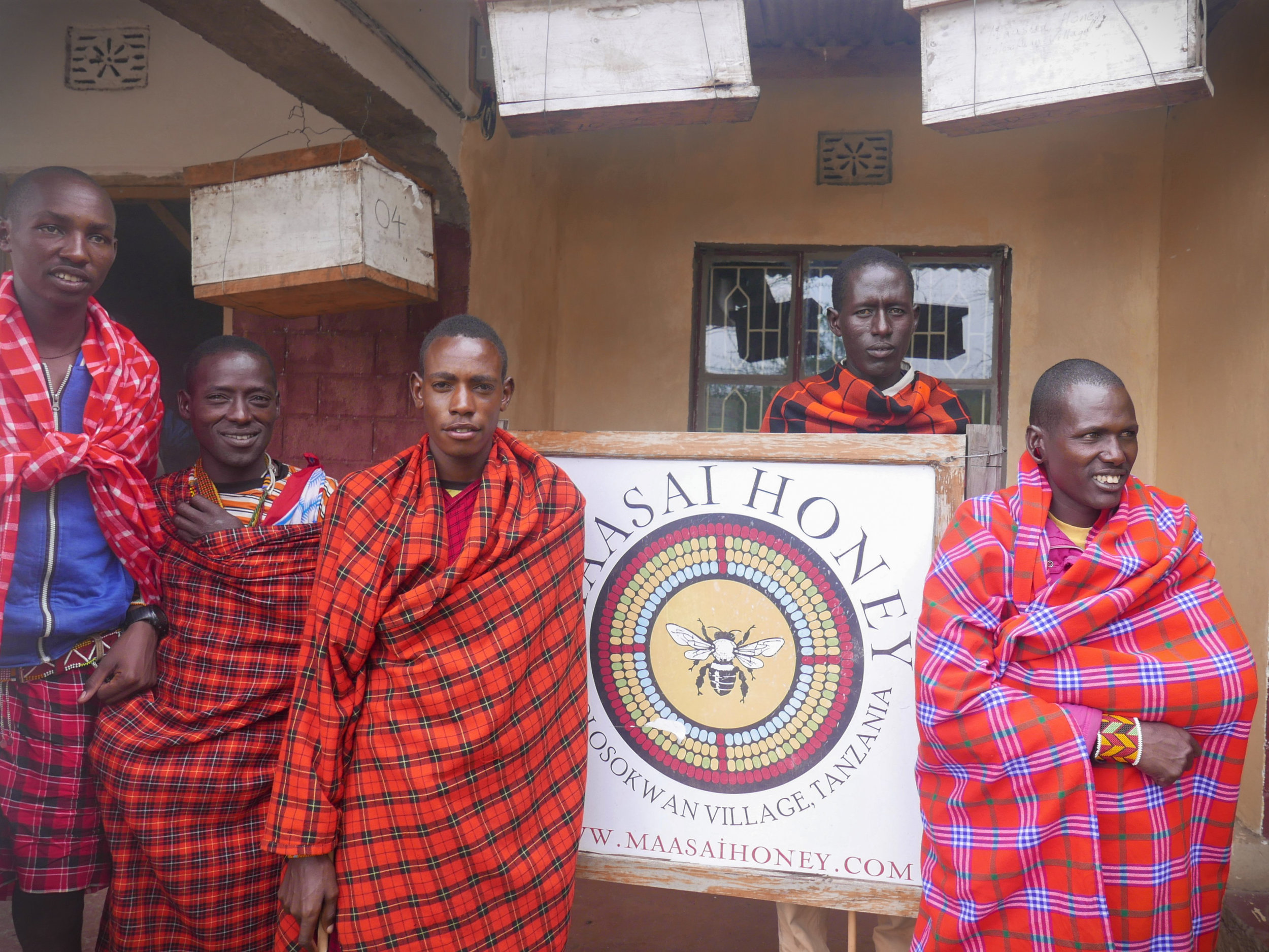 Maasai Honey apiary guards at our office where the stingless beehives are hung.