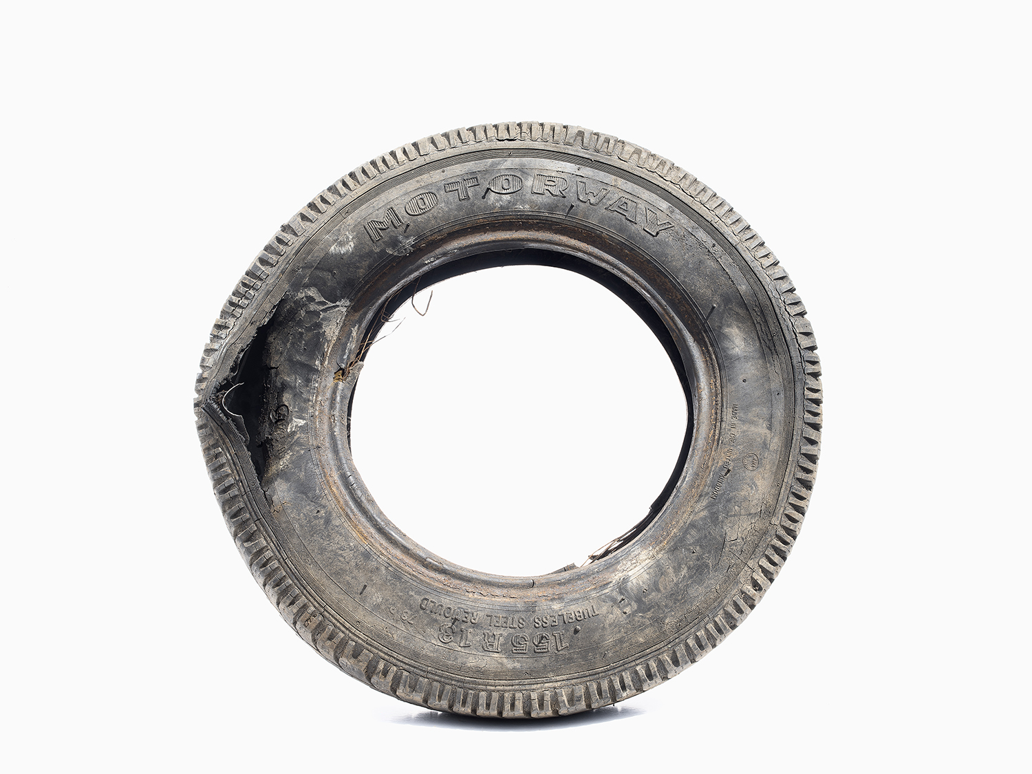 Waste tire, Devon, United Kingdom, Giclée print from digital medium format, 90x120cm, 2017.    If we consider historic responsibility for greenhouse gas emissions, we gain a very different understanding of who is responsible for climate change. When we focus on who is currently emitting the most greenhouse gasses, blame often falls on developing nations that actually have relatively short-lived emission histories and / or smaller carbon footprints per person than that of many developed nations. Our perception of who is responsible for climate change can dramatically change when we look at emissions in different ways. For example, the United Kingdom has arguably the longest-lived historic responsibility for climate change, being the first nation to industrialise and emit large quantities of greenhouse gases during the industrial revolution. The U.S. long held the title as the world's greatest emitter until 2005 when it was overtaken by China, which is now the world's greatest emitter of all time. But when we look at the carbon footprint per person we find that Luxembourg and the U.S. surpass China as the top-ranking emitters. However, a focus on the political geography of emissions greatly simplifies the narrative of who is responsible. With corporations emitting on a global scale and operating outside the control of any one state, we find that emissions are in fact being outsourced to developing nations by developed nations. Just because a corporation's factories release emissions in China doesn't mean that its headquarters are not in London or Washington D.C. Just 100 fossil fuel companies are now believed to be responsible for 71 percent of emissions since 1988. This outsourcing of emissions is a form of slow violence that derives from the very same colonial practices that led to the development of some nations over others. Yet instead of being based, as in the past, solely upon resource grabbing, this re-branding of colonialism is now also concerned with the redi