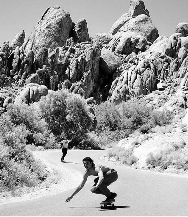 Pablo Skating by Desert Mountains