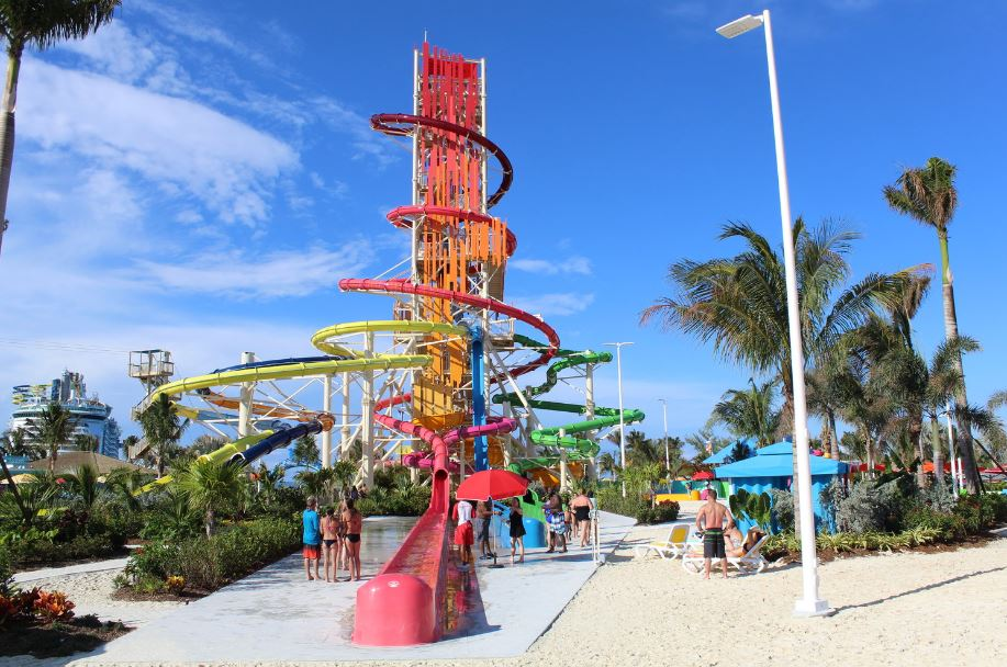 View of Daredevil Tower — you will test your limits on seven extreme slides including twin Dueling Demons drop slides (yellow and dark purple slides) and the duo of Manta Raycers (pink and orange slides); the high-speed, fully vertical Screeching Serpent (blue slide); the coiling Green Mamba (dark green slide); and the 135-foot-tall Daredeevi's Peak (red slide).
