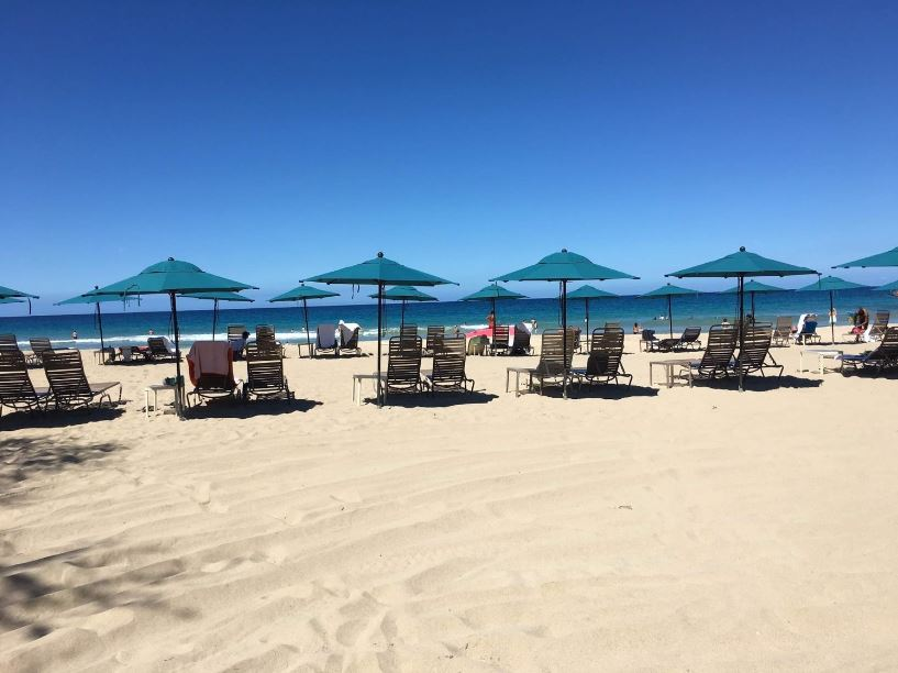 Relaxing at Hapuna Beach under the shade of umbrellas and the comfort of nice lounge chairs