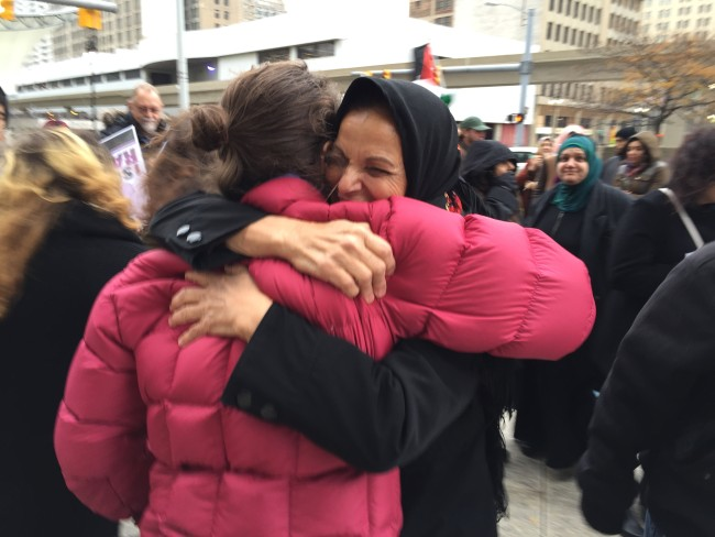 Rasmea Odeh, Palestinian-American icon, hugs one of her supporters.