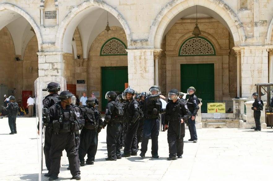 Israeli Defense Force soldiers stand outside Al-Aqsa mosque doors last summer. | Rasha Abousalem