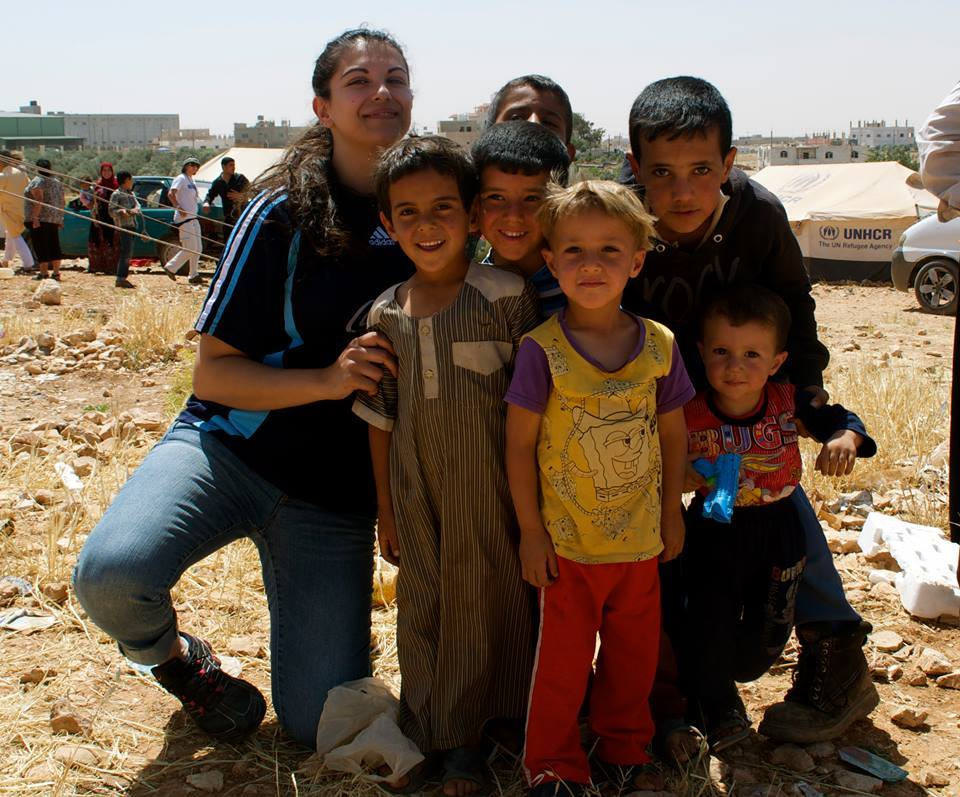 Rasha Abousalem (left) with a few Syrian refugees at a camp in Sahaab, Jordan.