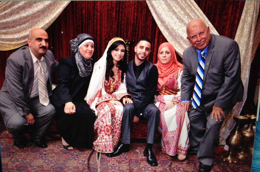 Nabil and Rehab Ihmoud pose with each of their parents after their henna party in October 2013. Studio Al Amal