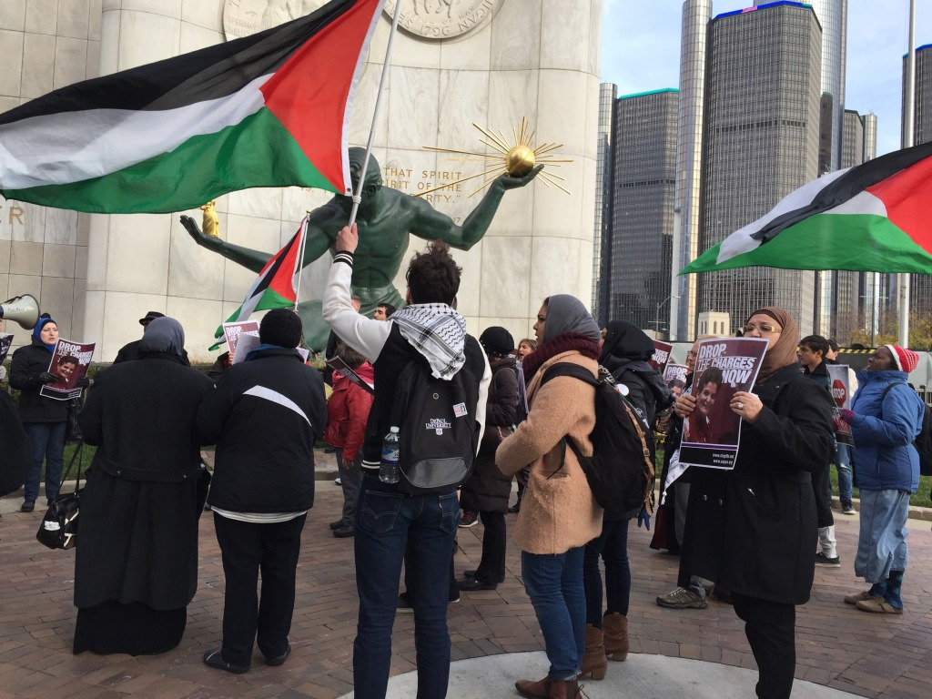 Rasmea Odeh's supporters marched through downtown Detroit after the Palestinian-American community leader was taken into custody.