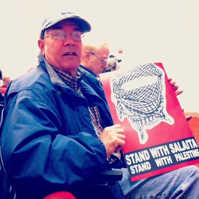"Ronald Schupp was in attendance for Steve Salaita's event at Columbia College Chicago's Ferguson Lecture Hall on Oct. 8th. He held a red sign that read: ""Stand with Salaita. Stand with Palestine."""