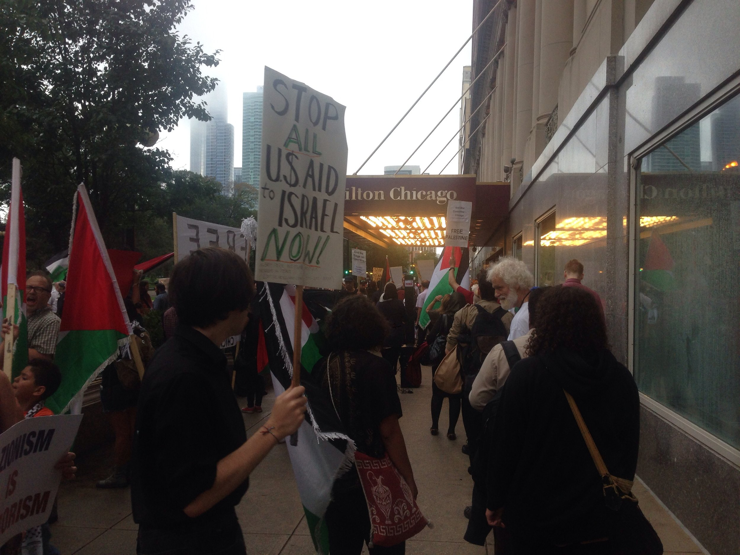 Demonstrators picket outside of the Hilton Chicago, 720 s. Michigan ave., while a fundraiser for the Israeli Defense Forces occurred inside the hotel on Aug. 21. | Nader Ihmoud