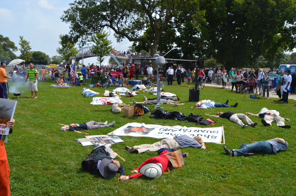 During a demonstration against Boeing, protestors held a die-in at North Ave. beach, where spectators came to watch the Air & Water Show. | Nader Ihmoud