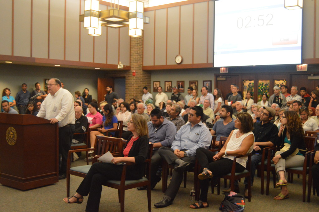 The Village Hall in Lincolnwood was filled to capacity Aug. 11 for the meeting about the Palestinian flag hanging in the village held by the Human Relations Commission. Many of the attendees were given 3 minutes to speak to whether or not the flag should be kept. | Nader Ihmoud