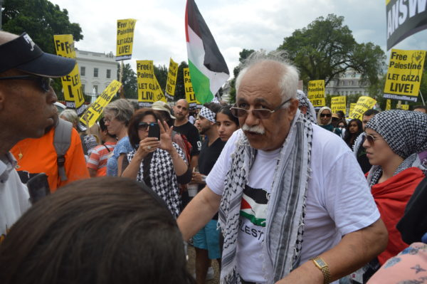 Aug. 2, 2014| A Palestinian American passionately tells another man why he's protesting for Palestine.