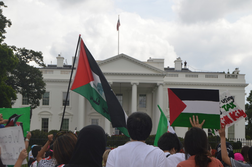 Aug. 2, 2014 |Protestors hold Palestinian flags in front of the White House.