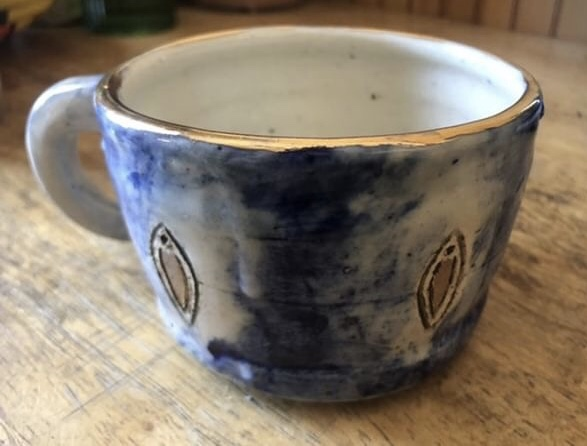 Handmade Yoni mug with porcelain clay and gold luster.