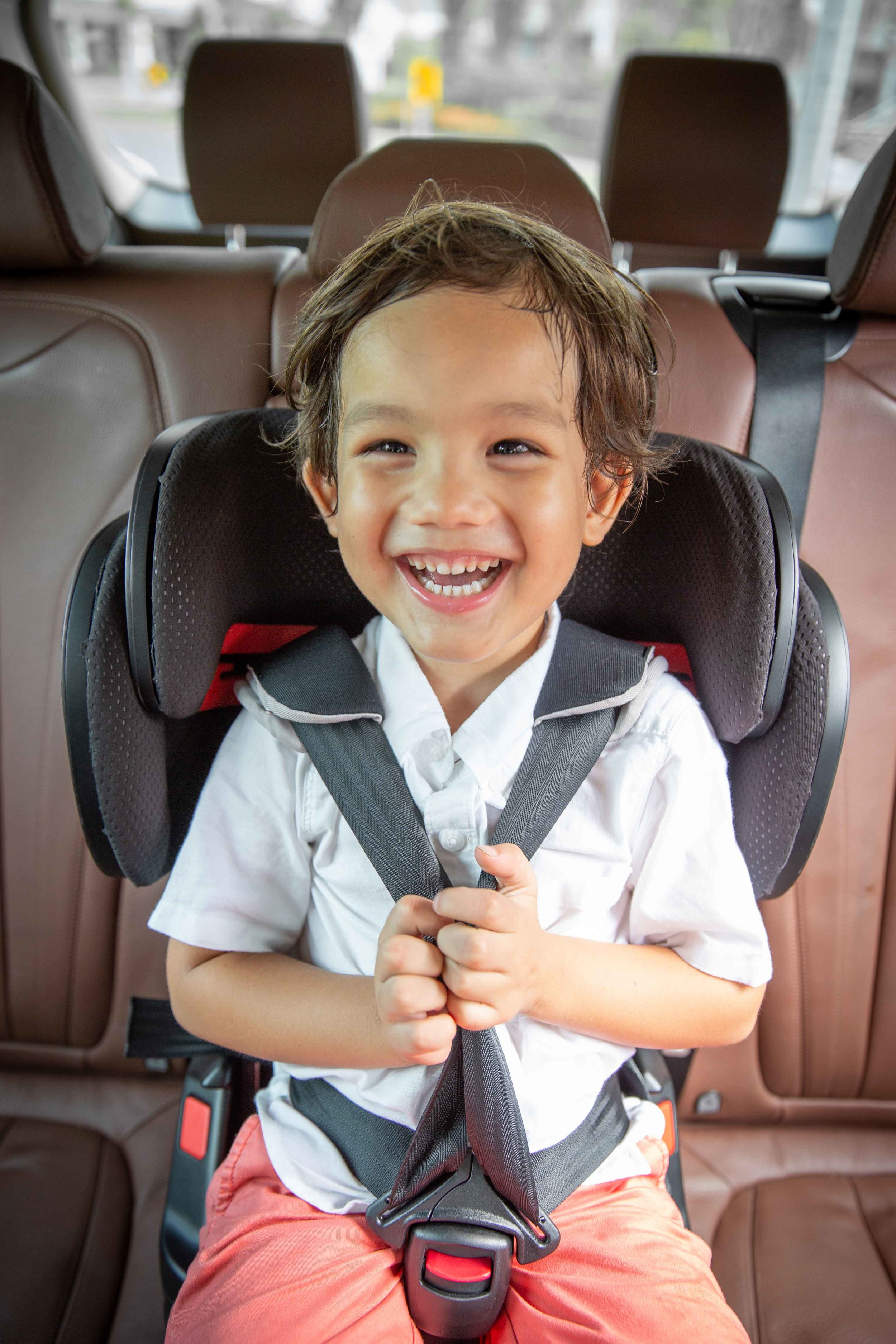 David's son Jakob, now 4 years old, enjoying his ride in the TinySeats children's car seat.