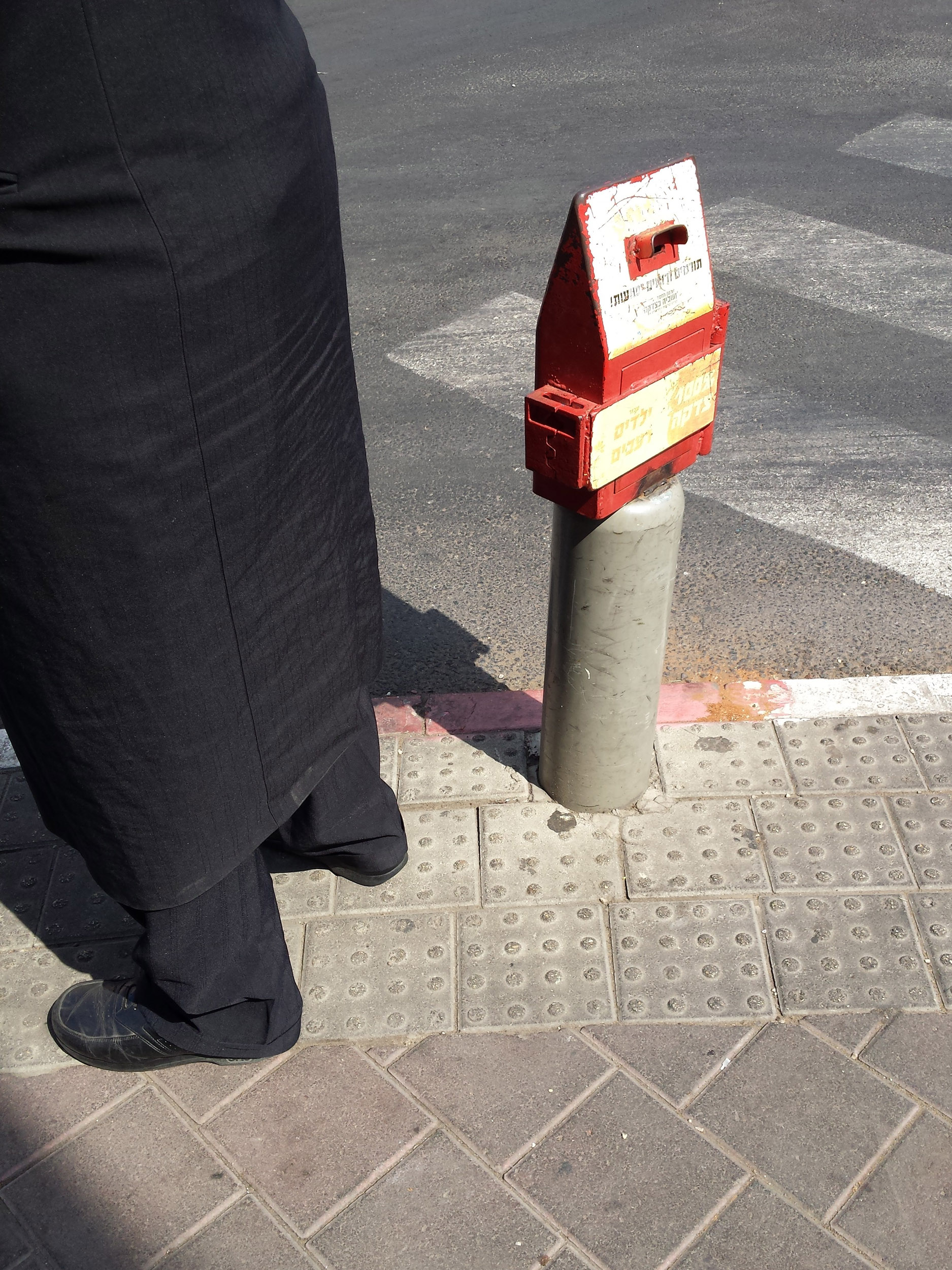 Public donation box on a Bnei-Brak street