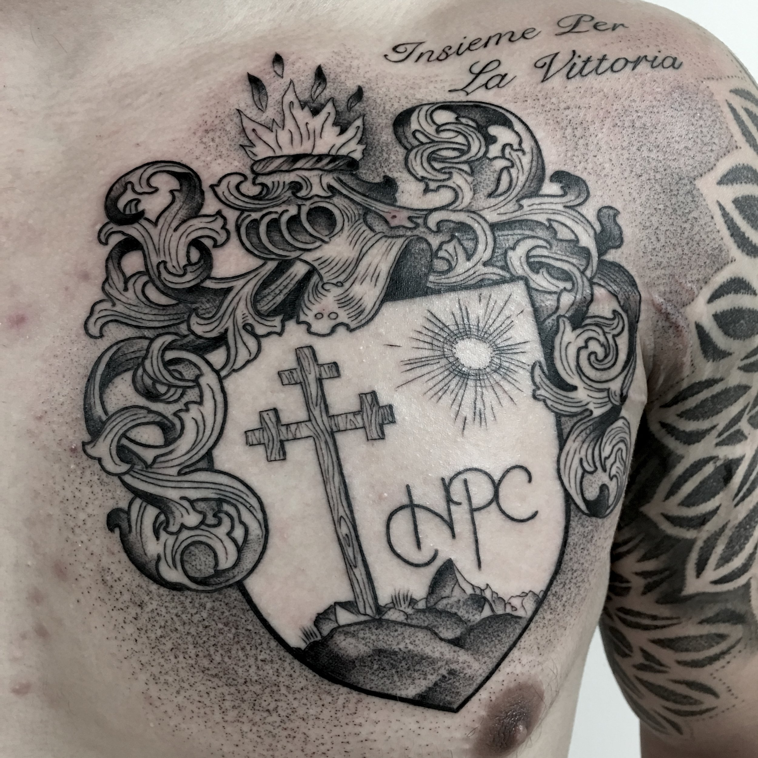 tattoo by brian foster EST riverside black work family crest