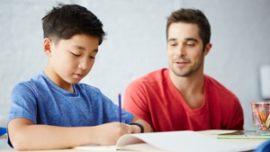 teenager working with tutor at lighthouse education, inc. in boston