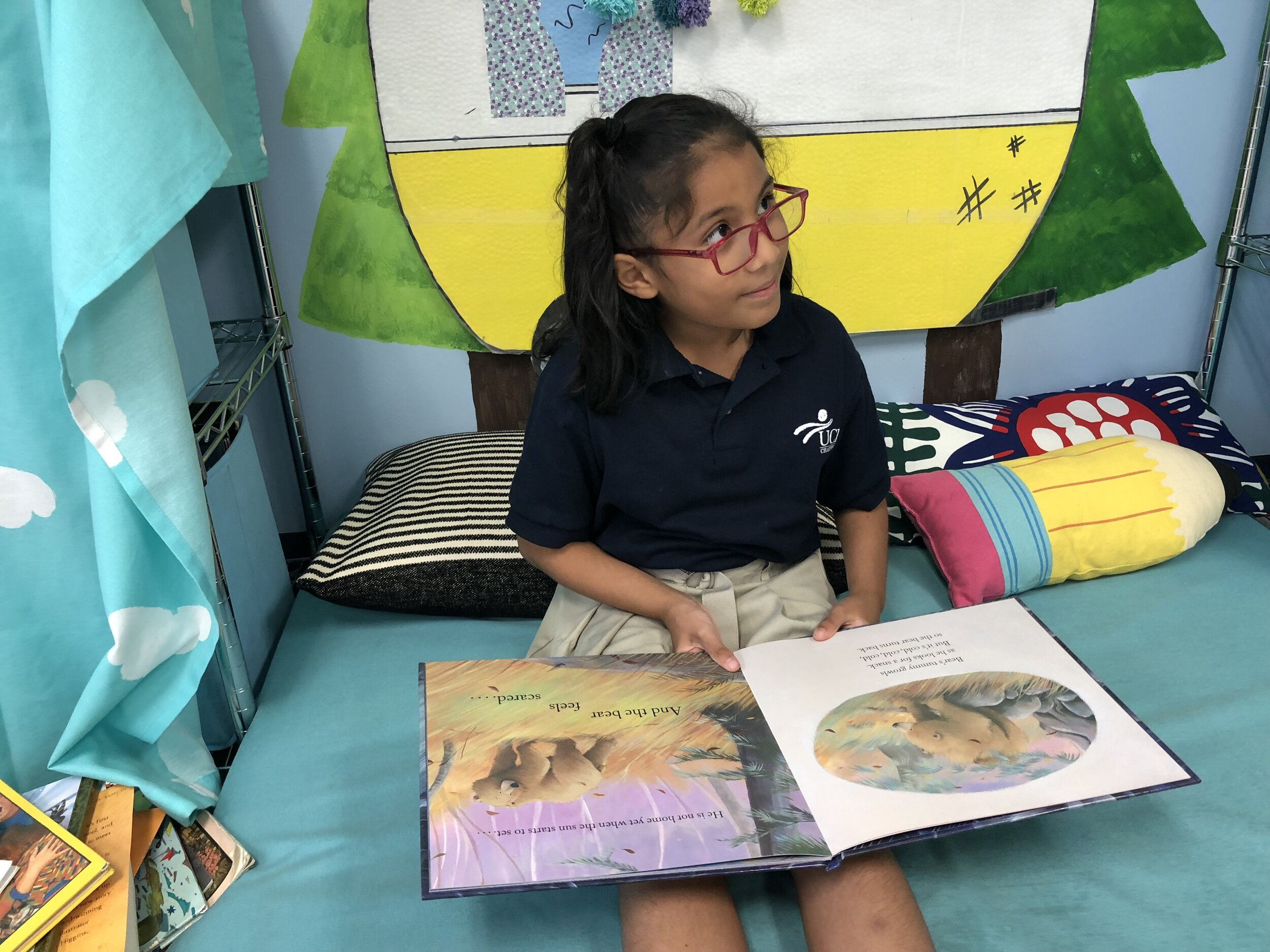 Pillows and books are used in a Safe Place, where students can practice regulating their emotions.