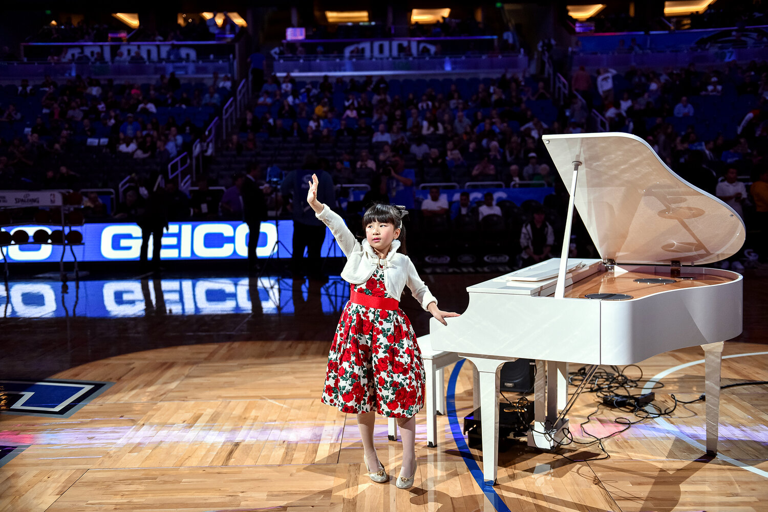 Abby Huang takes a bow at the NBA's Orlando Magic halftime show.