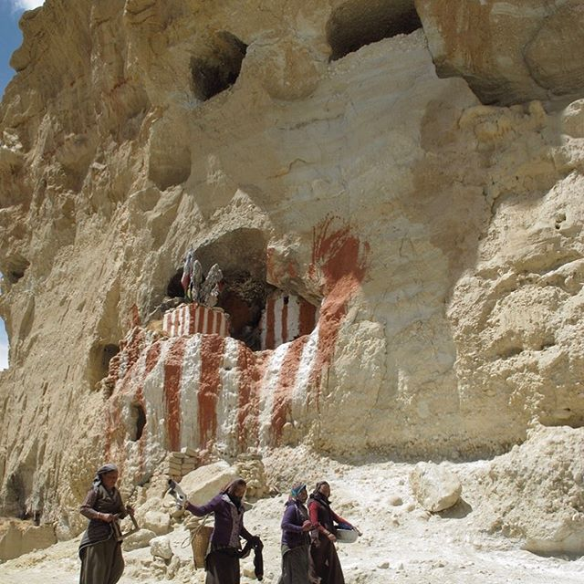 April/2012 _ Northern Mustang District, Nepal  Troglodyte caves carved into ocher cliffs. The red and white, primitive paintings on the large mouth of the cave form an impressive backdrop behind the women who accomplish together with smile, elegance and simplicity their daily tasks ... . . . #travel #explore #adventure #instapic #picoftheday #neverstopexploring #takeyouwithme #ivanaboris #lifeisanadventure #thesecretlifeofivanaboris #neverstopexploring #photographer #discovertheworld #theworldisyours #travel #lifeofadventures #nationalgeographic